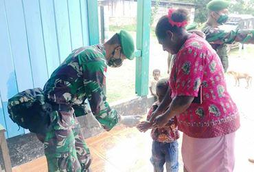 Satgas Yonif 125/SMB Semprotan Disinfektan di Gereja ST. Petrus Kampung Bupul