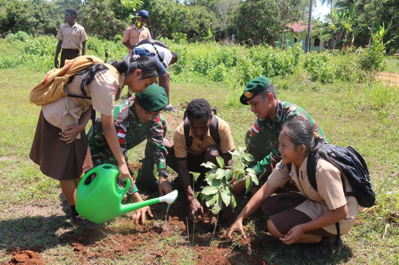 Peringati HMPI Satgas Pamtas RI-PNG Yonif 411 / Pdw Budayakan Cinta Tanam Pohon
